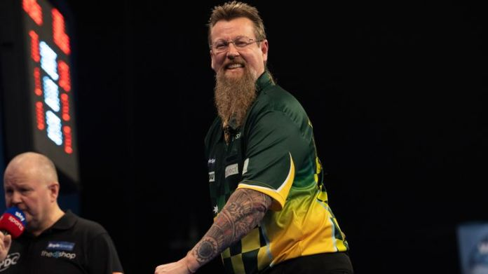 Simon Whitlock continued his return to form by battling through the Grand Slam of Darts qualifier to secure a return to the tournament for the second time in three years