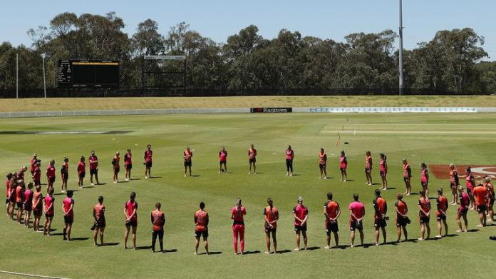 Players form a barefoot circle before the Women's Big Bash League match between the Perth Scorchers and the Sydney Sixers on November 11