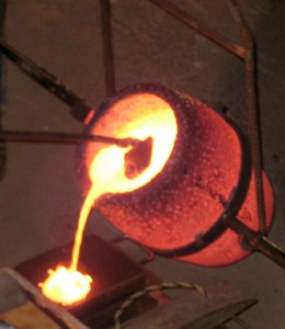 Pouring bronze into a form