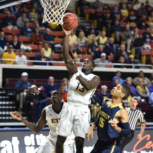 A.J. Merriweather goes up for a layup, as ETSU defeated Averett to advance to 1-0