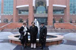 Elizabeth Crawford, Mary Wagner and George Nichols, three of the four undergraduate students to desegregate ETSC in 1958, pose in front of the fountain made in their honor in front of the Sherrod Library in 2013. / Johnson City Press