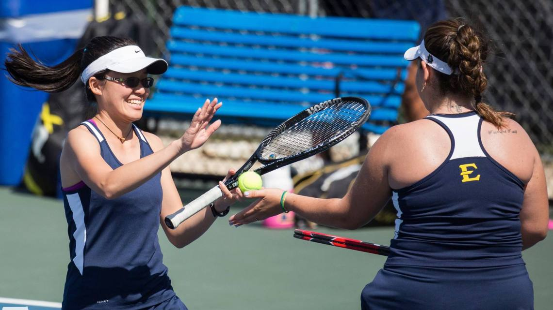 Ana Gerbasi (right) and Lyn Yee Cho (left) playing doubles match against Wofford. Photo courtesy of etsubucs.com. Photographed by Dakota Hamilton.