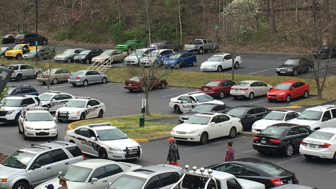 Student Quarters residents congregated outside of Building B Monday while Johnson City Police searched an apartment after a shooting. (Photograph by Dylan Chesser/ East Tennessean)
