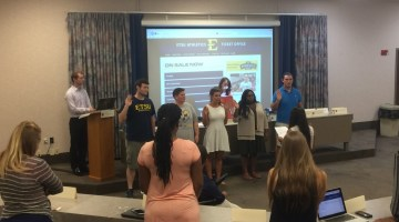 SGA president Pooja Shah swears in the new cabinet members at the August 23 meeting. (Photograph by: Jordan Hensley)