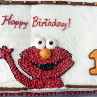 An Elmo themed vanilla birthday cake (whole wheat, eggless, natural colors)