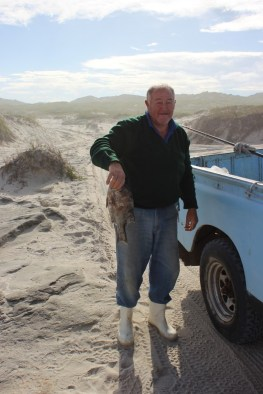 Very happy local fisherman on the beach near Grootbos
