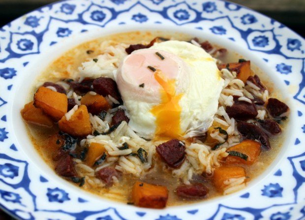 Chicken and ham broth with rice, pumpkin, chorizo, sage and a poached egg