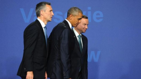 US President Barack Obama, center, walks with Polish President Andrzej Duda, right, and NATO Secretary General Jens Stoltenberg at the NATO summit in Warsaw, Poland, Friday, July 8, 2016. Starting Friday, US President Barack Obama and leaders of the 27 other NATO countries will take decisions in Warsaw on how to deal with a resurgent Russia, violent extremist organizations like Islamic State, attacks in cyberspace and other menaces to allies' security during a summit described by many observers as NATO's most crucial meeting since the 1989 fall of the Berlin Wall.(AP Photo/Alik Keplicz)