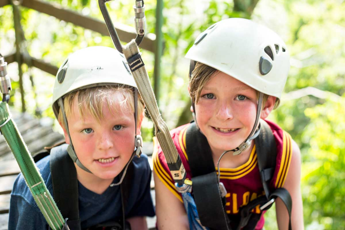 Ziplining is a fun tourist activity in Belize, Puerto Rico, Mexico and more