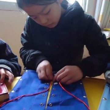 Lin-working-with-lace-manipulatives