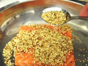 Coat the salmon with sesame seeds