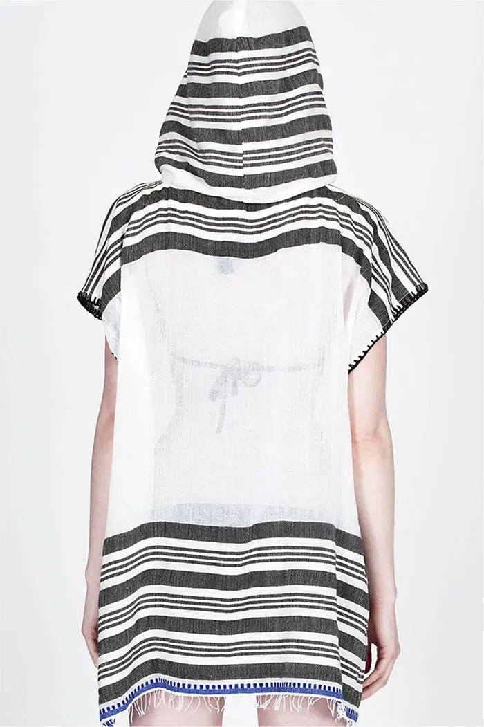 This LemLem poncho is fairly made in Ethiopia.