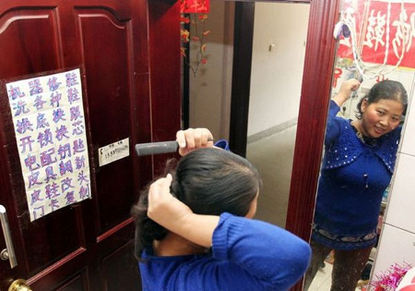 Chinese family lives in rented toilet, transforms it into cosy home