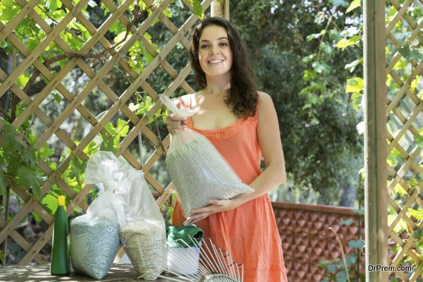 Woman with fertilizer granules in bag