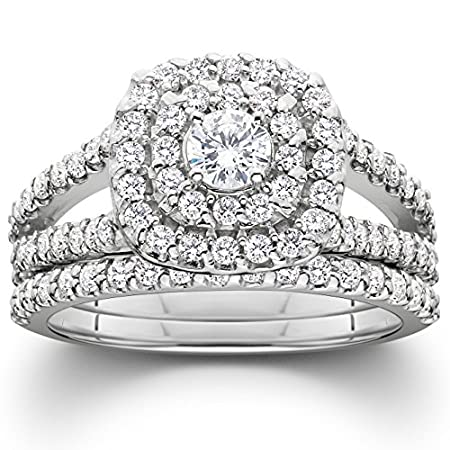 This womens ring features a 1/5ct round diamond center stone and accent diamonds set in solid white gold.