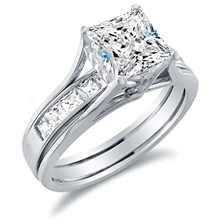 Solid 14k White Gold Bridal Set Princess Cut Solitaire Engagement Ring with Matching Channel Set Wedding Band Highest Quality CZ Cubic Zirconia 2.0ct. This brand new ring has a dazzling high polish finish. Solid and Pure 14k Gold, NOT plated. Authent...