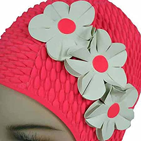 Look as if you have flowers tucked in your ear with this vintage styled ribbed textured swim cap with side petals. Old world charm mixed with Hollywood glamour makes this cap a delight.Bathing cap is one size and fits most adults.Three flowers made o...