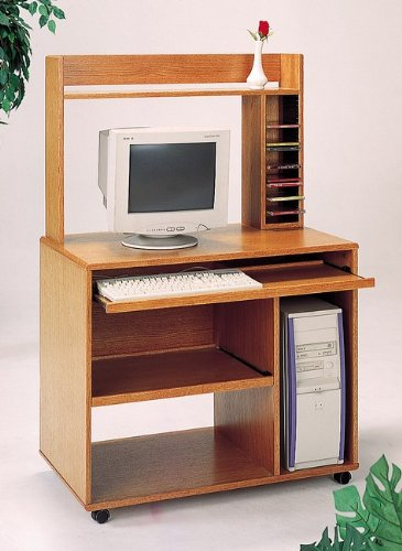 Picture of Comfortable Oak finish computer desk with bookcase , sliding keyboard tray and casters (B000XBTCNC) (Computer Desks)