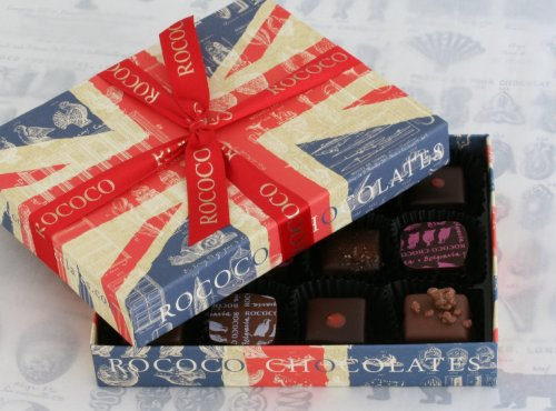 An eclectic array of Rococo's signature chocolates in a Union Jack Box. This selection includes traditional favourites such as rose creams and pink marc de champagne truffles and more adventurous flavours such as chilli truffles and orange, mango and passion fruit chocolates.  This box contains: Rose and violet creams in dark chocolate Dark chocolate-coated stem ginger Pink marc de champagne chocolate truffles Dark chilli chocolate truffles Almond marzipans Venus nipples (coffee ganache in white chocolate) Lemon praline ganache in milk chocolate Rose, raspberry and lychee ganache in dark chocolate Orange ganache with mango and passion fruit jelly in milk chocolate