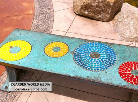 Closeup of mosaic tile bench with metal
