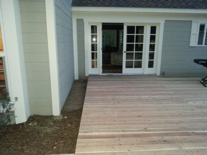 planting strip between deck and house of Home and Family show before the makeover- right side