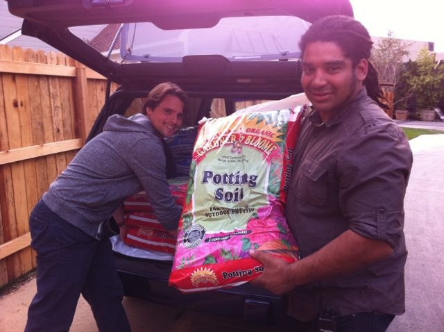 Producer Nick and assistant Will, unload the potting soil from Kellogg