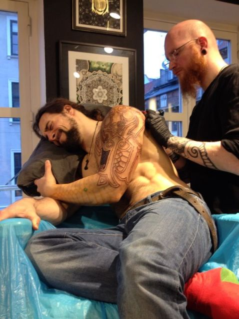 Being tattooed by Peter Madsen