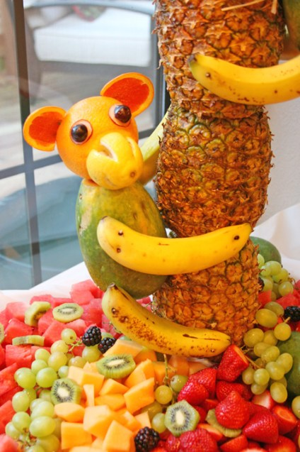 This incredible fruit display for a luau a pineapple tree with fruit