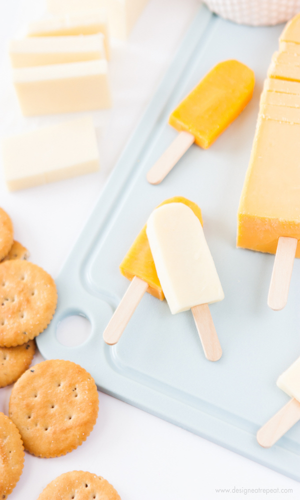 Turn-cheese-slices-into-mini-popsicles-with-this-fun-cheese-board-idea