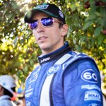 IndyCar star Justin Wilson awaits his turn at the winner's circle podium, Lime Rock Grand-Am 2013