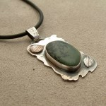 Beach Stone Pendant with adornments