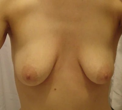 round natural c cup breasts