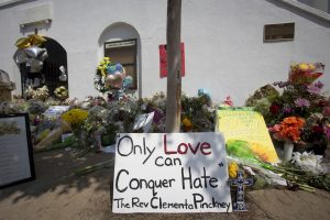A sign is pictured at a makeshift memorial for victims of a mass shooting, outside the Emanuel African Methodist Episcopal Church in Charleston