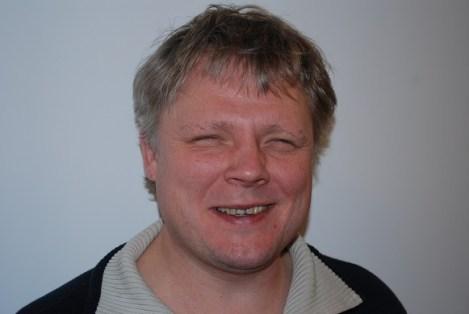 Portrett av Morten Tollefsen, smiler