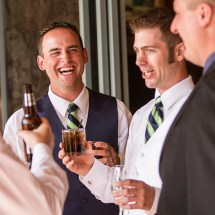 Groomsmen sharing a moment jsut before wedding