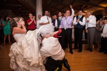 The bride blushes in this fun wedding moment