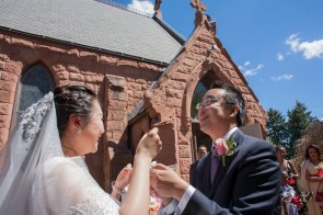 Cutting Cake at University of Denver Wedding