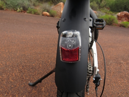 The rear LED taillight is powered by the e-bike battery and it is attached to the rear fender.