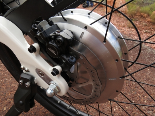 The rear Tektro Aurigia disc brake and the 500 watt direct drive motor.