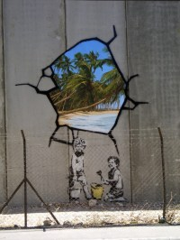 Well-known UK graffiti artist Banksy hacks the Wall | The ...