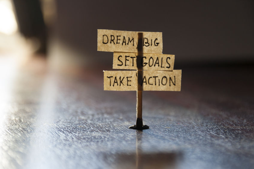 29609415 - dream big, set goals, take action, concept, tags on the table.
