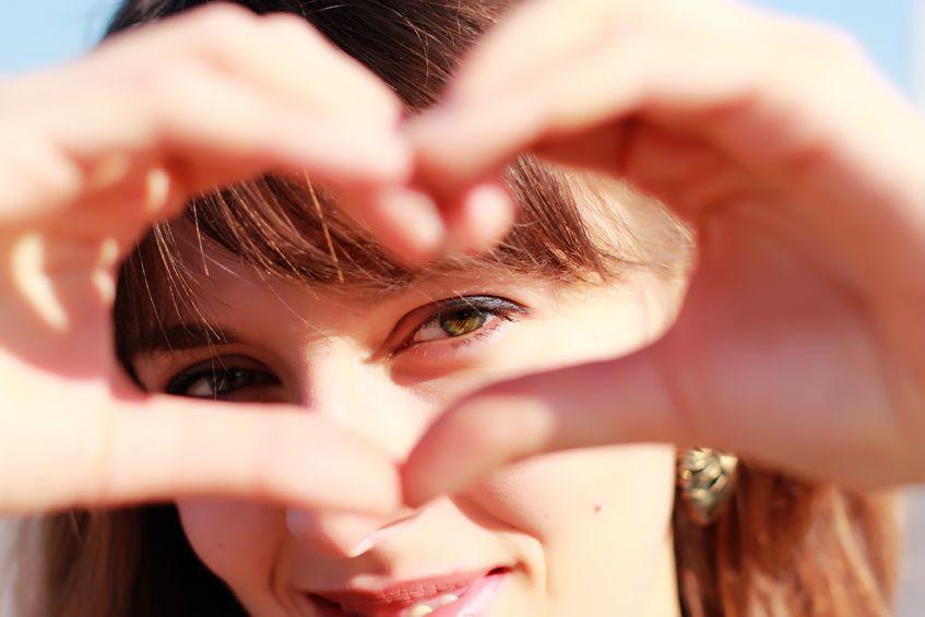12119346 - beautiful girl show love sign