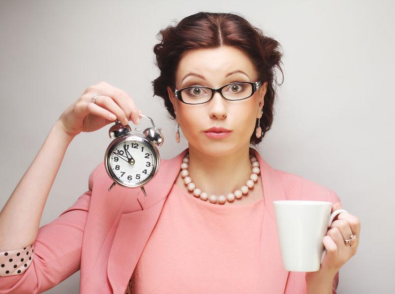 37584490 - young funny businesswoman having a coffee-break