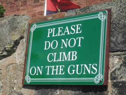 Please do not climb on the guns