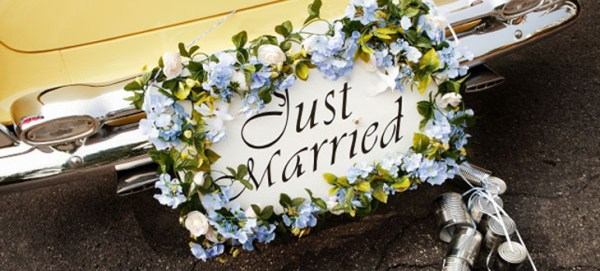 Just married sign on a back of a limousine