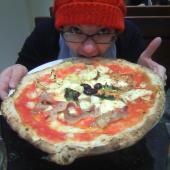 Katie noshing on her quattro stagione pizza