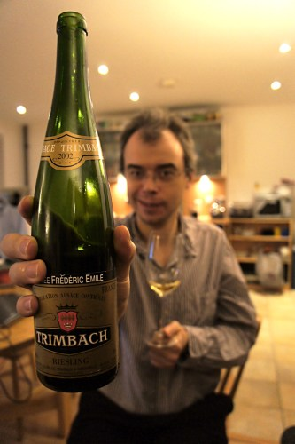 David brandishing a bottle of Riesling Cuvee Frederic Emile 2002 from Trimbach
