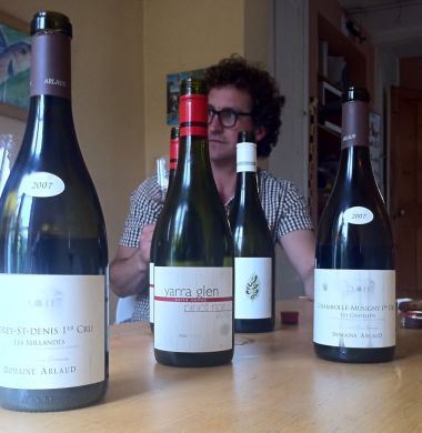 Mac Forbes looking cool behind a collection of wines