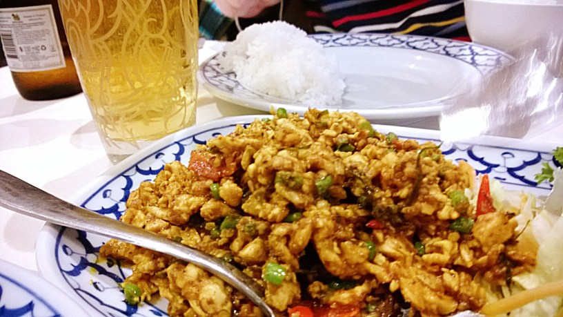 Dry stir fried chicken with coriander root and chillies