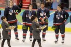 past USA players after they lost to Canada 3-2 in the men's gold medal